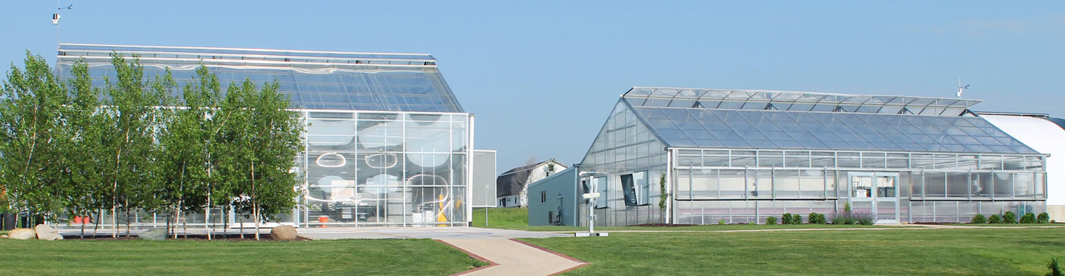 outside of two commercial greenhouses